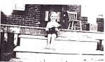 My dad, Robert Williams, now 78, sitting on the porch of the original brick house built by Caleb and Gloranah.